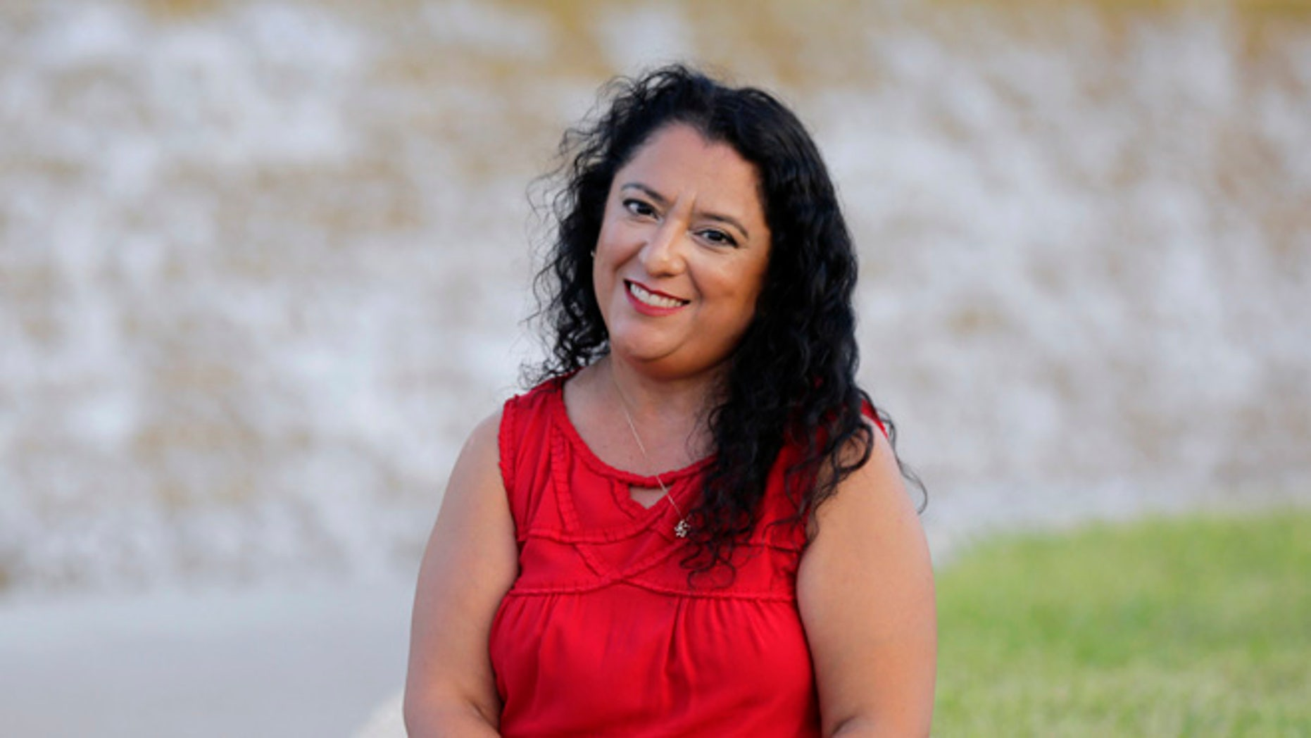 """Rebecca Esparza, a two-time cancer survivor, poses for photos at the Watergardens in Corpus Christi, Texas on Thursday, July 14, 2016. She says repealing the federal Affordable Care Act, as Republicans have tried to do dozens of times in Congress, could make her uninsurable. """"I realize this is something that could happen... It's a terrifying thought for me not to have any insurance at all."""" (AP Photo/Eric Gay)"""