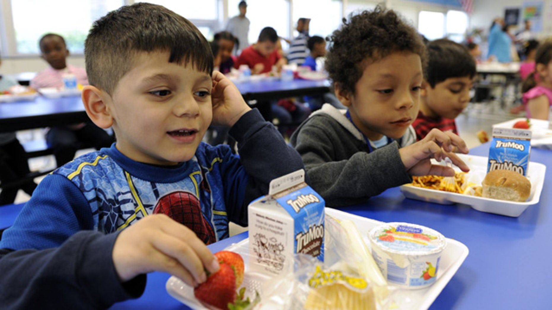 April 29, 2014: Biden Arias-Romers, 5, left, and Nathaniel Cossio-Boatwright, 6, right, eat lunch at the Patrick Henry Elementary School in Alexandria, Va. (AP Photo/Susan Walsh)