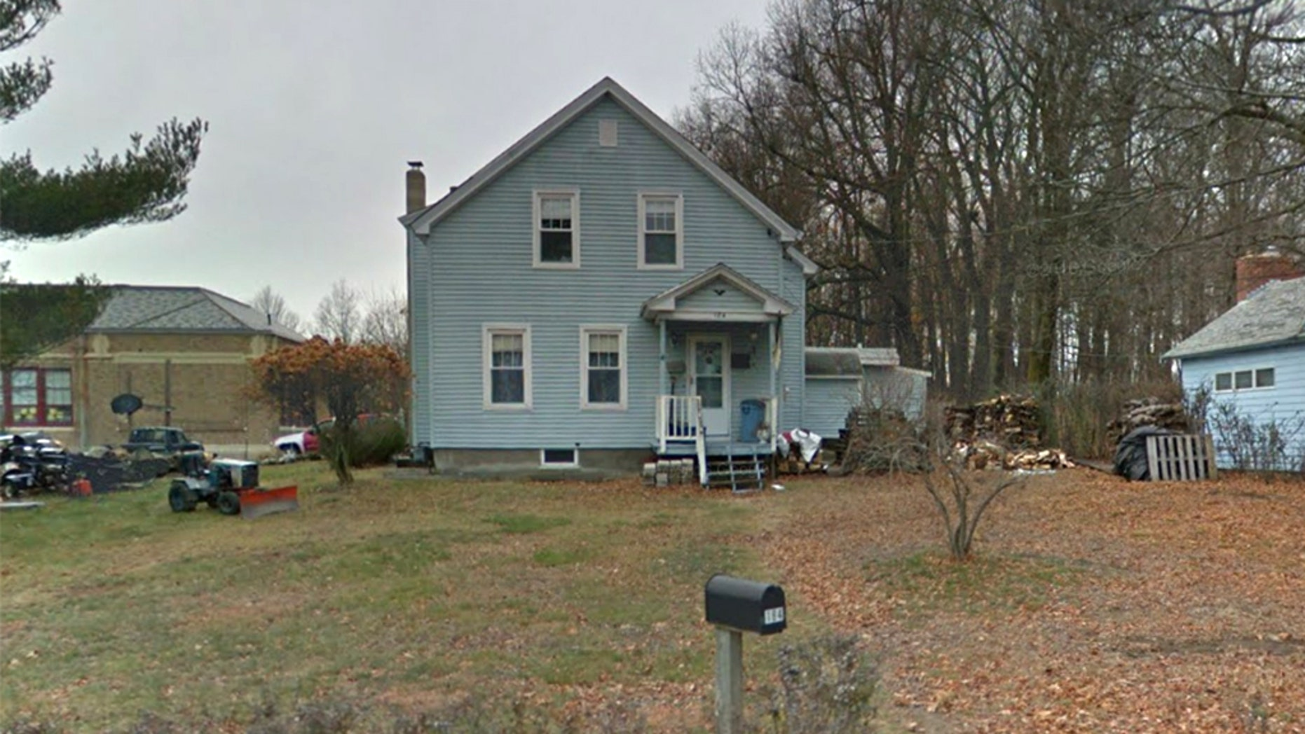 A woman died after falling into a fire pit at this home in Worcester, Massachusetts, fire officials said.