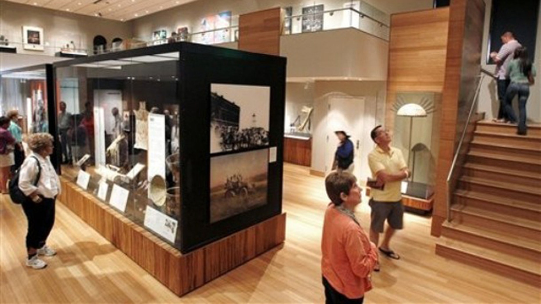 Feb. 12, 2012:  Patrons walk through an exhibit featuring Geronimo and other Apache tribe warriors in history at The Heard Museum in Phoenix.