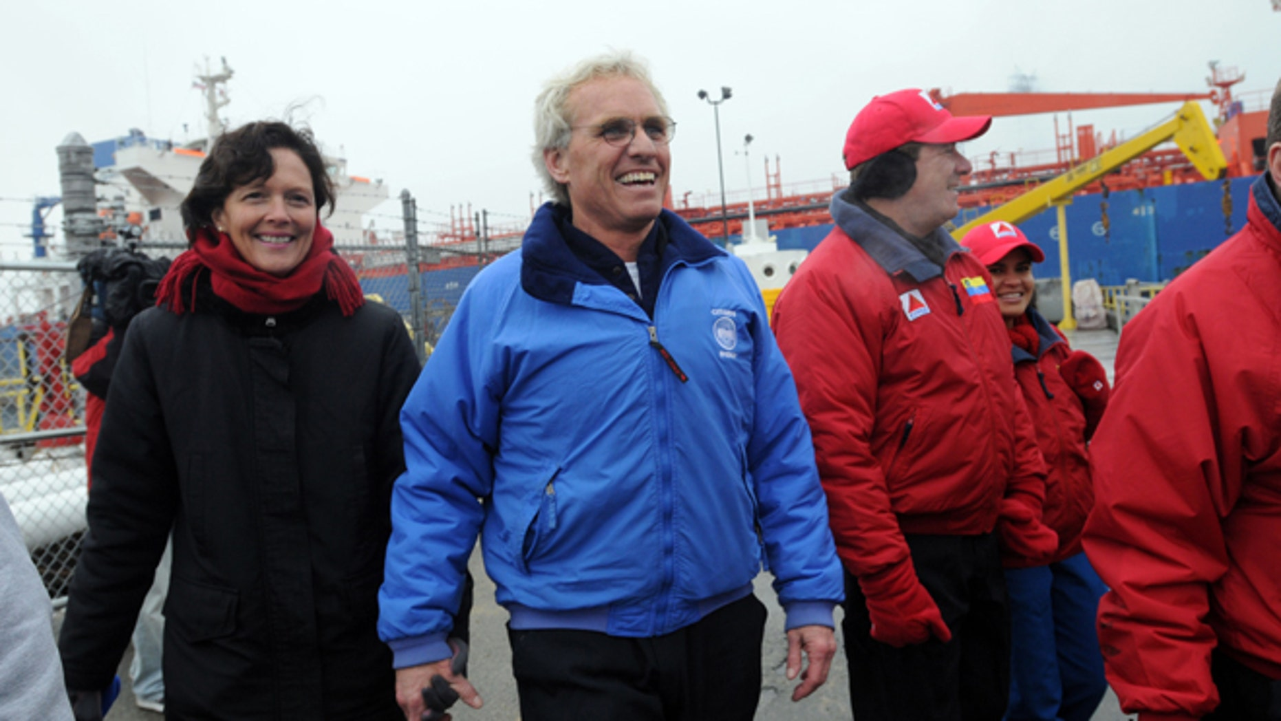 BRAINTREE, MA - DECEMBER 10:  Citizens Energy Chairman Joseph Kennedy and his wife Beth walk into Citgo Braintree Terminal after entering into Boston Harbor aboard the MS Simon, which was transporting low cost heating oil, December 10, 2007 in Braintree, Massachusetts. The oil, arriving from Venezuela, will be distributed through Citizens Energy to low income households in the United States at a 40 percent discount.  (Photo by Darren McCollester/Getty Images)