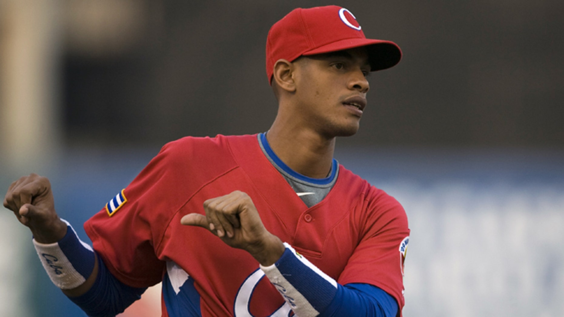FILE - In this March 10, 2009, file photo, Cuba's Hector Olivera attends training before a World Baseball Classic game against Australia in Mexico City. Hector Olivera and the Los Angeles Dodgers have agreed to a $62.5 million, six-year contract, agent Greg Genske said. The agreement includes a $28 million signing bonus, Genske said Tuesday, March 24, 2015.(AP Photo/Claudio Cruz, File)