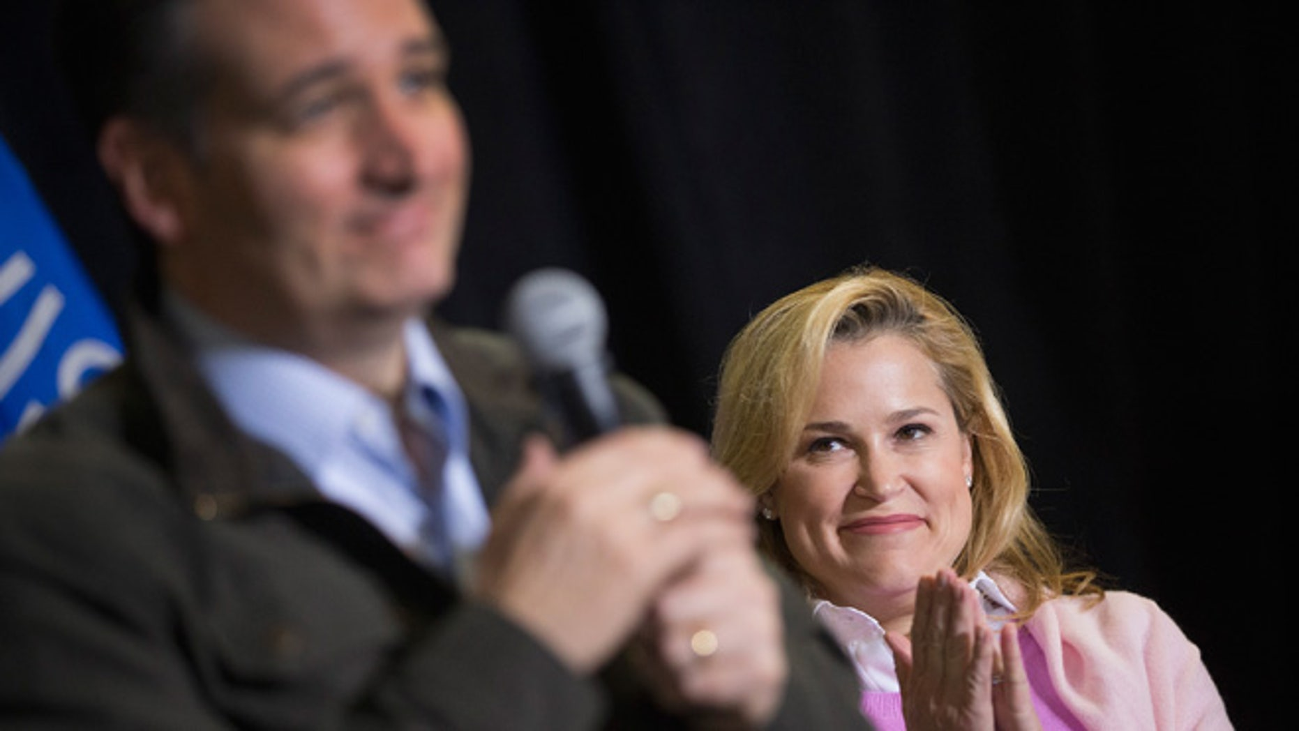 DANE, WI - MARCH 24:  Heidi Cruz listens as her husband Republican presidential candidate Sen. Ted Cruz (R-TX) speaks to workers at Dane Manufacturing during a campaign stop on March 24, 2016 in Dane, Wisconsin. Wisconsin voters go to the polls for the state's primary on April 5.  (Photo by Scott Olson/Getty Images)