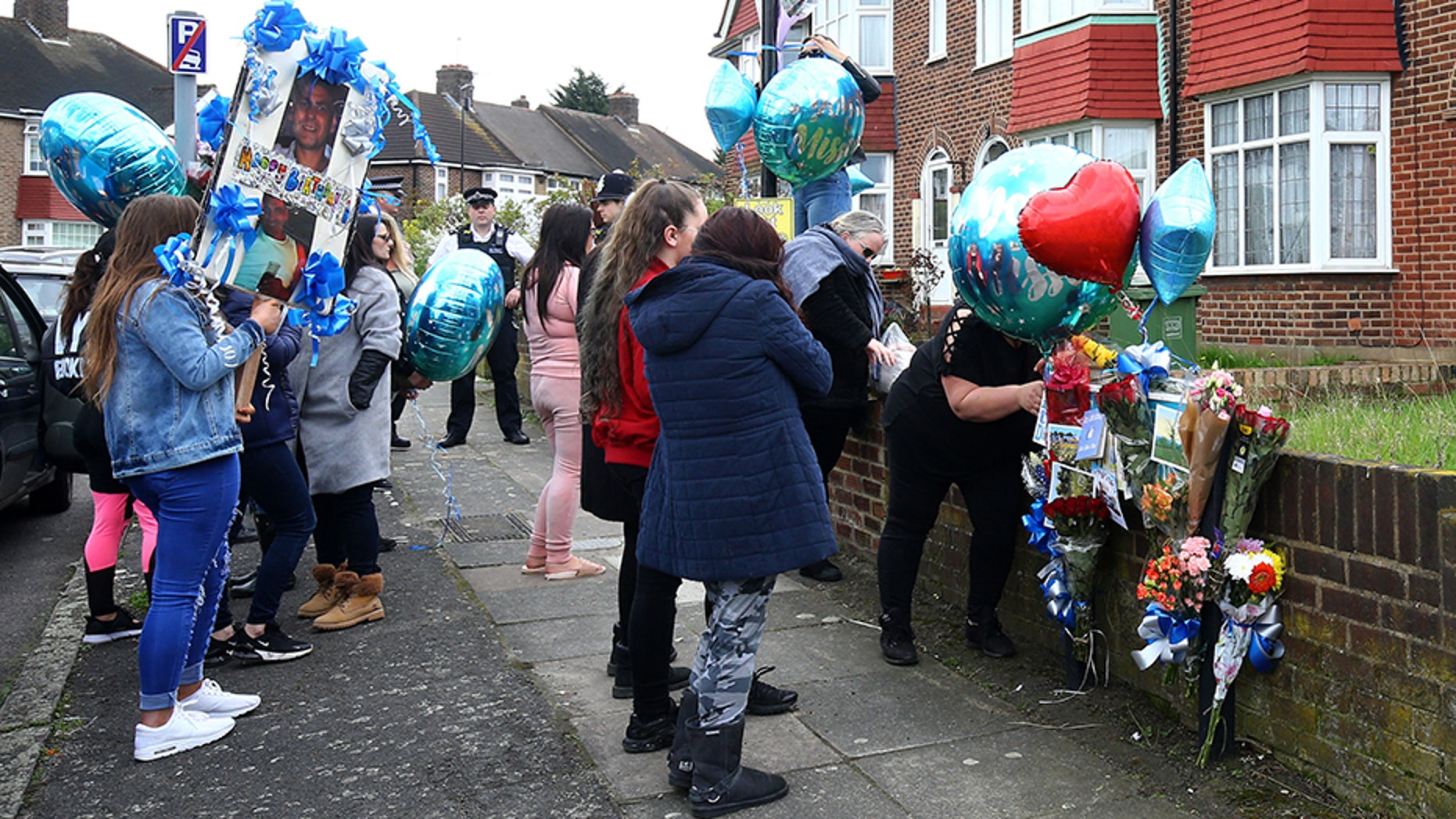 A group of women brought flowers and balloons to the spot in London where Henry Vincent was fatally stabbed in botched burglary at the home of an elderly man, Richard Osborn-Brooks. Vincent would have turned 38 Sunday.