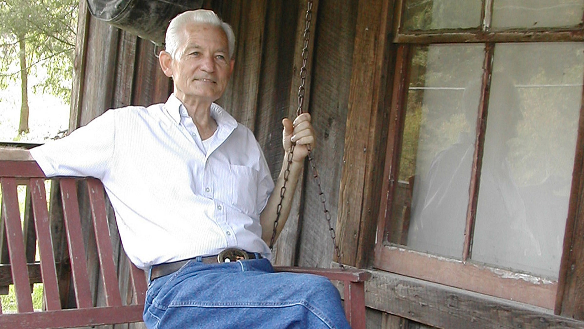 Herman Webb, brother of country music star Loretta Lynn, sits on the porch of the home they grew up in at Butcher Hollow, outside Van Lear, Ky., on Oct. 3, 2002.