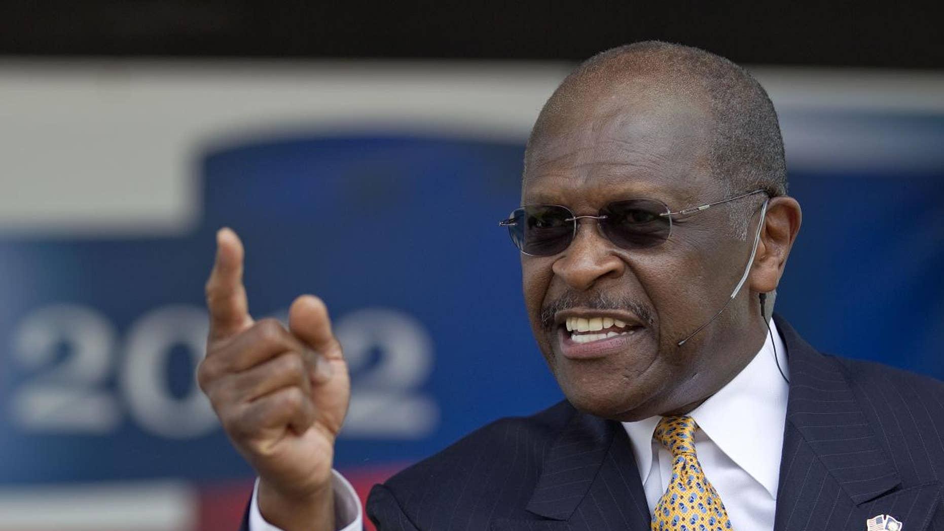 Herman Cain announces his run for Republican candidate for president at a rally Saturday, May 21 in Atlanta. (AP Photo/David Goldman)