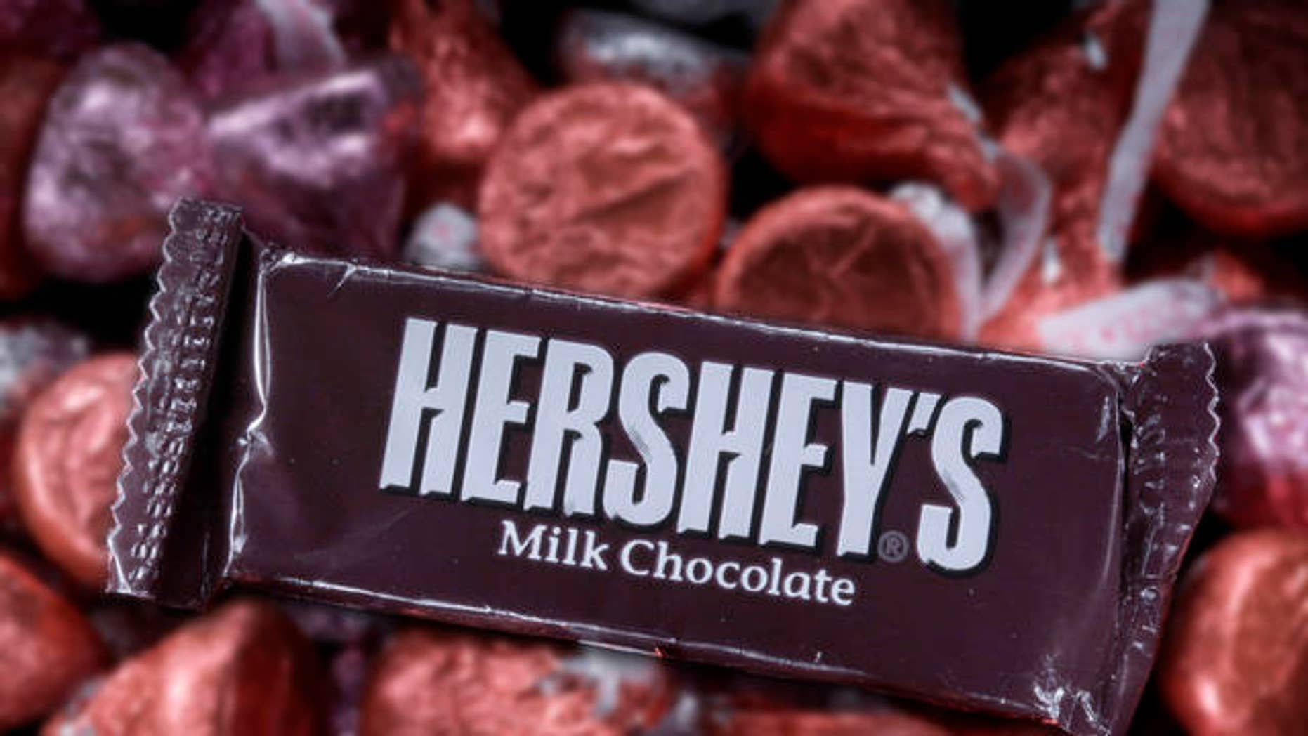 A Hershey bar rests amid Valentine Hershey's kisses in Moreland Hills, Ohio on Monday, Feb. 1, 2010.  (AP Photo/Amy Sancetta)
