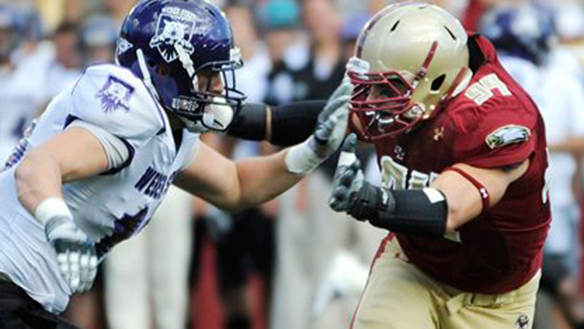 In this Sept. 4, 2010, file photo, Boston College's Mark Herzlich, right, rushes against Weber State's Brian Jankowski during an NCAA college football game in Boston. Herzlich is heading into the NFL draft after missing a season with BC because of cancer. The linebacker returned to play in 2010 and is one of 25 college players scheduled to attend the draft in New York that begins Thursday night, April 27.