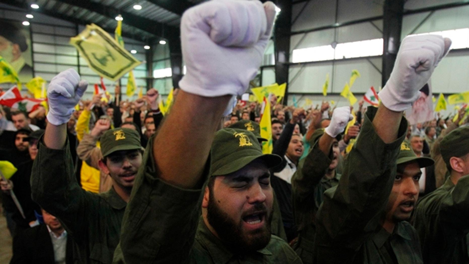 November 11, 2011: Lebanon's Hezbollah militants chant slogans as their leader Sayyed Hassan Nasrallah speaks during a rally marking Hezbollah's Martyr's Day in Beirut's suburbs