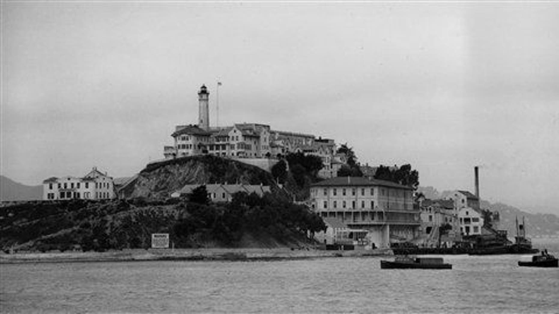 Three armored railroad cars arrive on a car ferry at the United States Penitentiary on Alcatraz Island, San Francisco in August 1934.