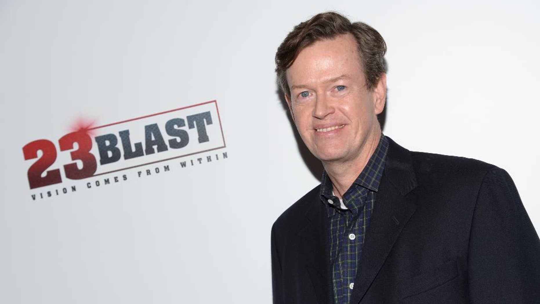"""FILE - In this Oct. 20, 2014 file photo, Actor/director Dylan Baker attends the premiere of """"23Blast"""" in New York. Baker tried to rescue an elderly neighbor before escaping a high-rise apartment fire in Manhattan, on Tuesday, Sept. 1, 2015.  Baker, who has a recurring TV role in """"The Good Wife,"""" said he had just returned home when an alarm went off and he saw smoke coming from his neighbor's apartment. Firefighters quickly put out the fire. The woman was hospitalized in critical condition. (Photo by Evan Agostini/Invision/AP)"""