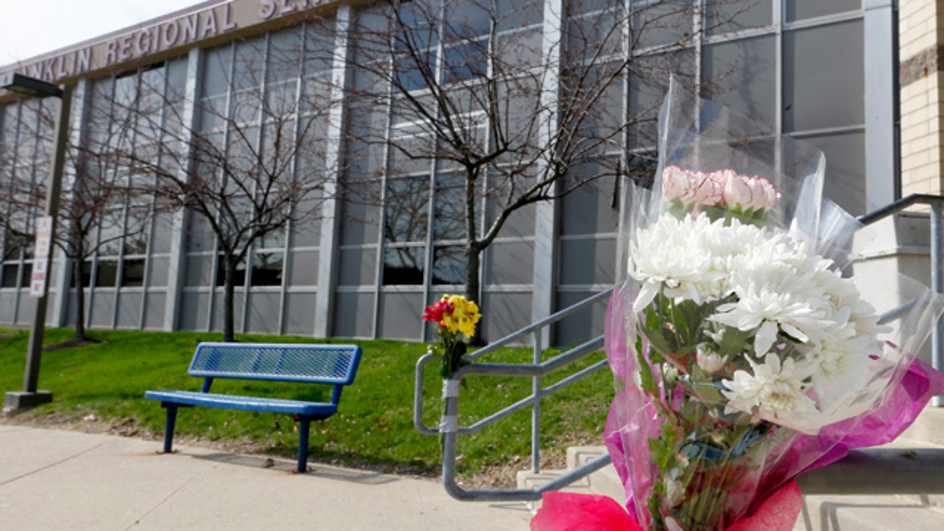 April 10, 2014: A bouquet of flowers is taped to a stairway rail near the closed entrance to Franklin Regional High School in Murrysville, Pa. (AP Photo/Keith Srakocic)