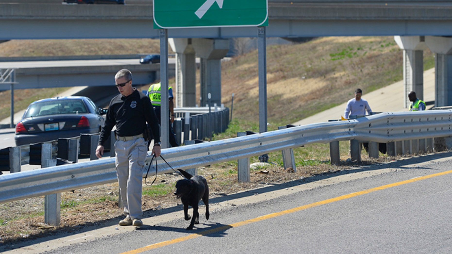 APRIL 9: Kansas City police and agents from the Alcohol, Tobacco and Firearms with canines investigated a shooting along southbound Interstate 435 in Kansas City, Mo.