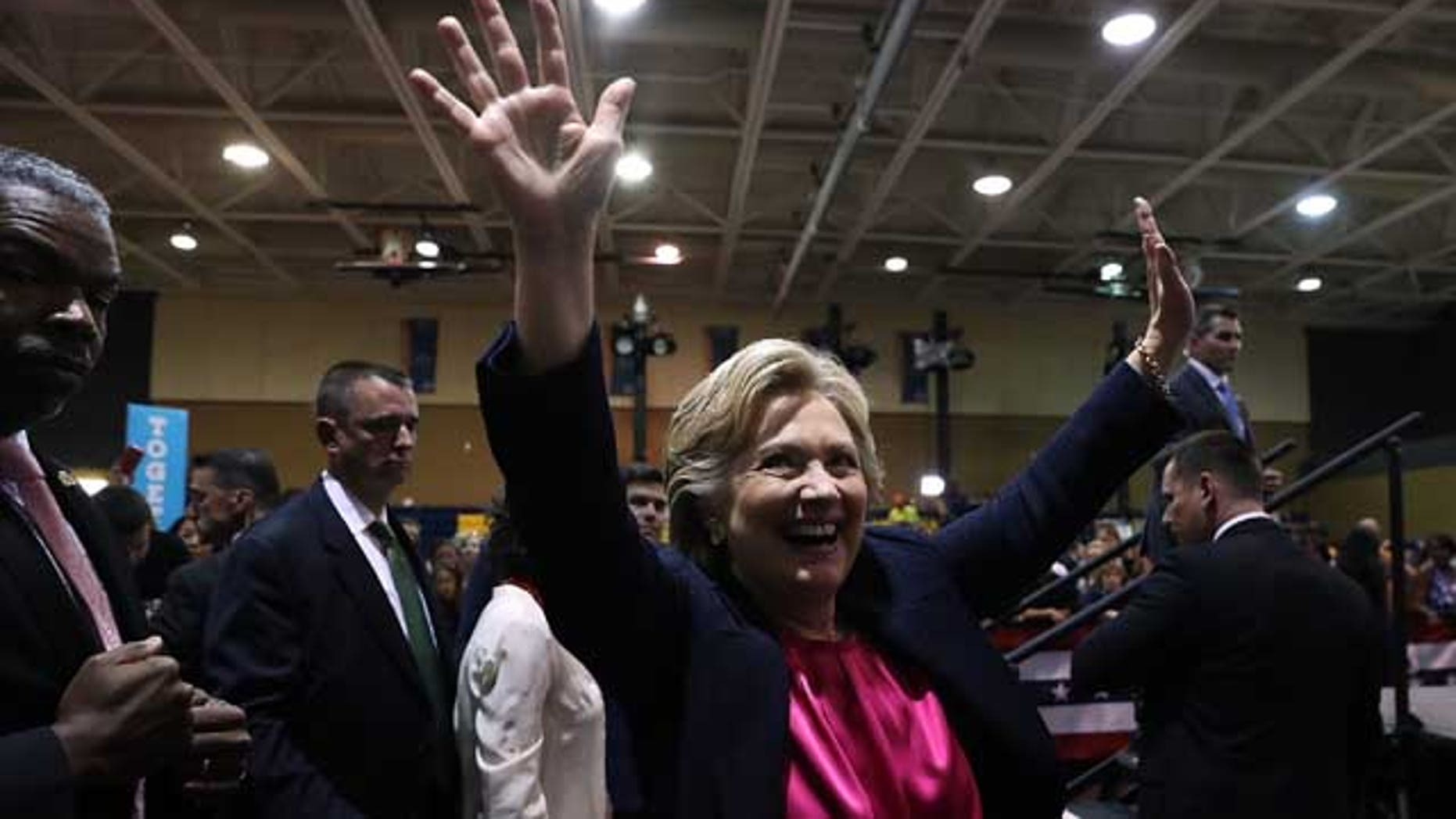 RALEIGH, NC - SEPTEMBER 27:  Democratic presidential nominee former Secretary of State Hillary Clinton greets supporters during a campaign rally at Wake Technical Community College on September 27, 2016 in Raleigh, North Carolina. Hillary Clinton is campaigning in North Carolina a day after facing off with republican presidential nominee Donald Trump in the first presidential debate.  (Photo by Justin Sullivan/Getty Images)