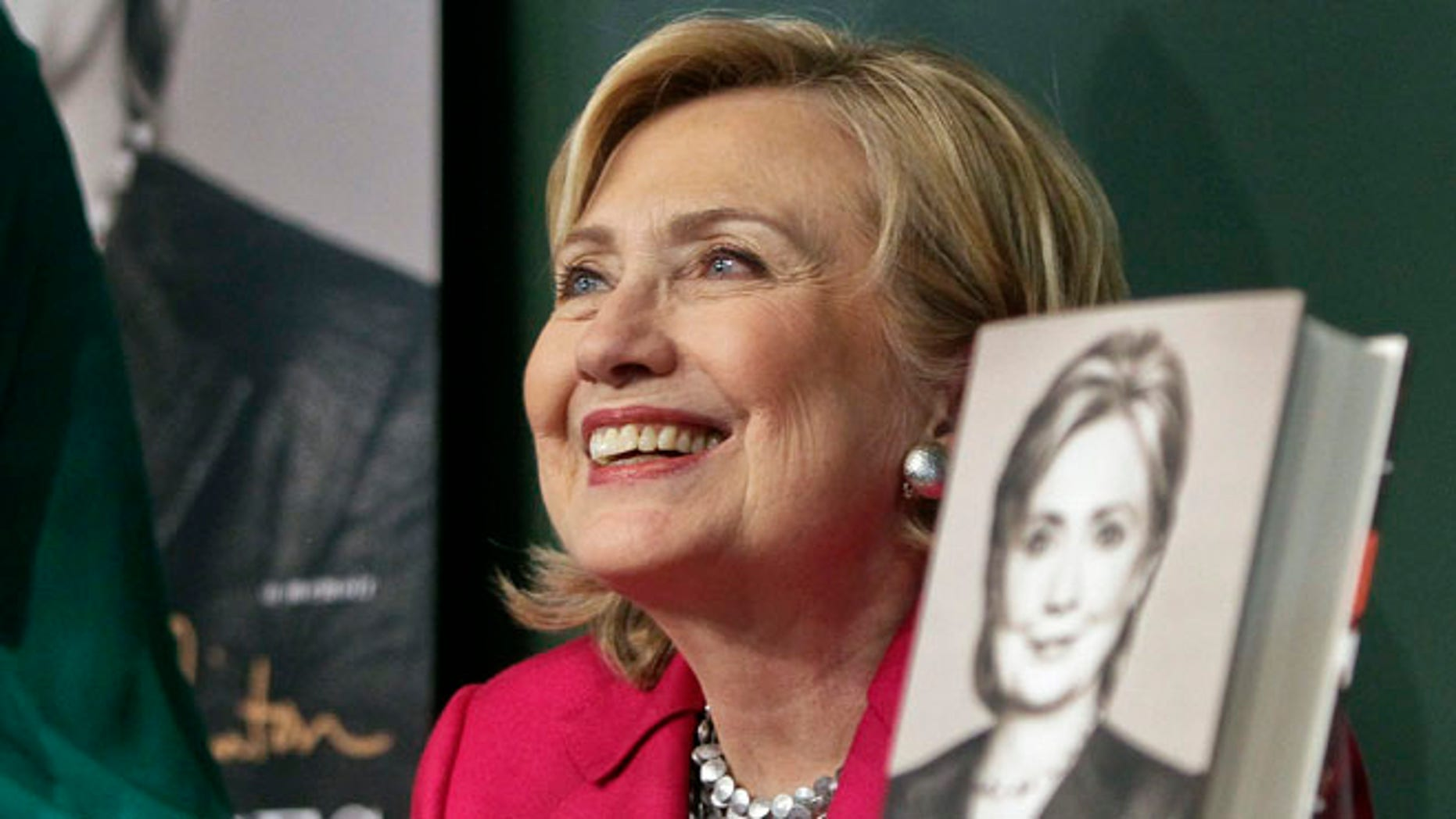 HiIlary Clinton listens before signing a copy of her book, Hard Choices, on Tuesday June 10, 2014, at Barnes and Noble bookstore in New York.