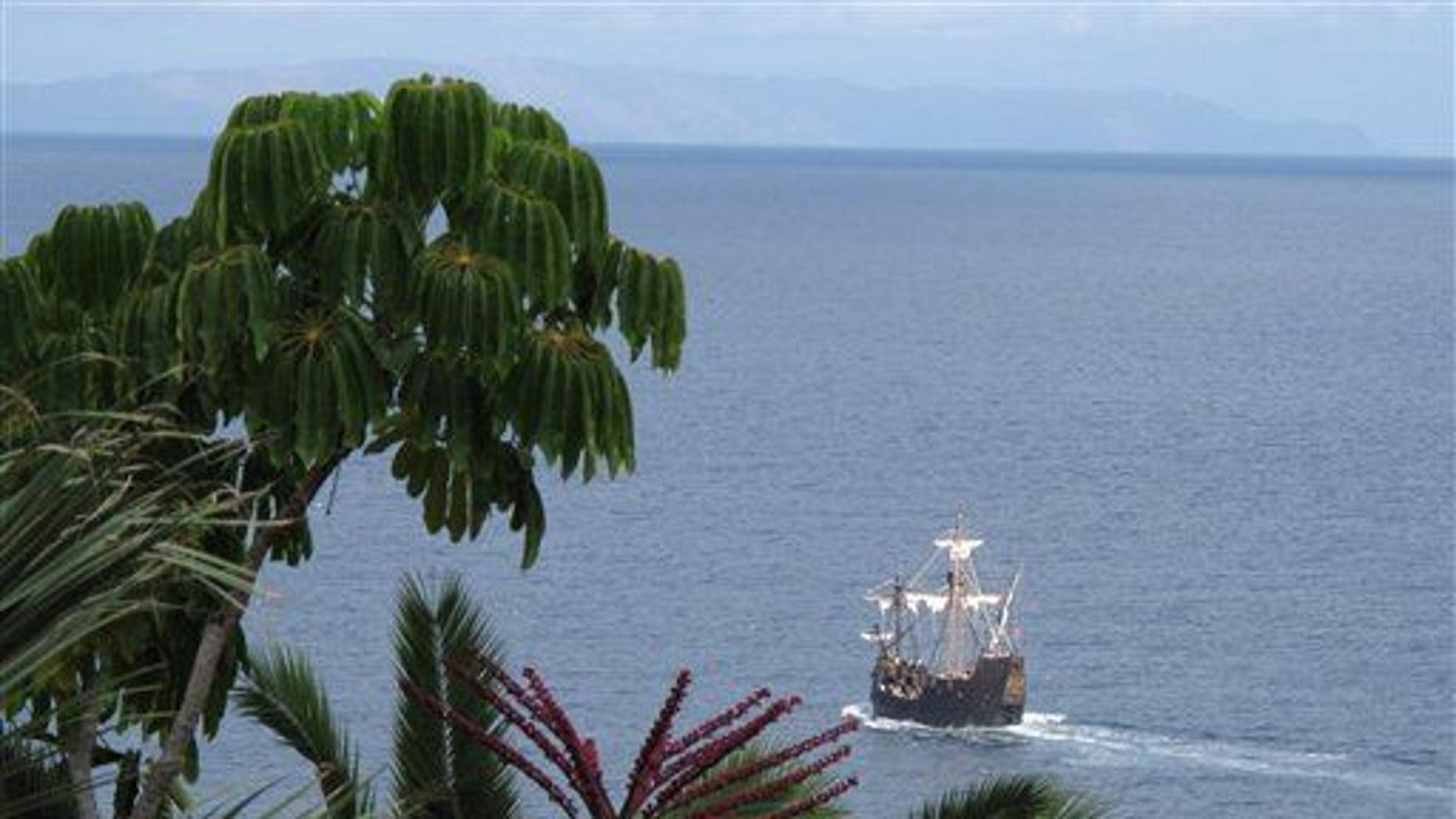 In this photo taken Sept. 12, 2011, a replica of Christopher Columbus' flagship, the Santa Maria, makes its way past the Portuguese island of Madeira.