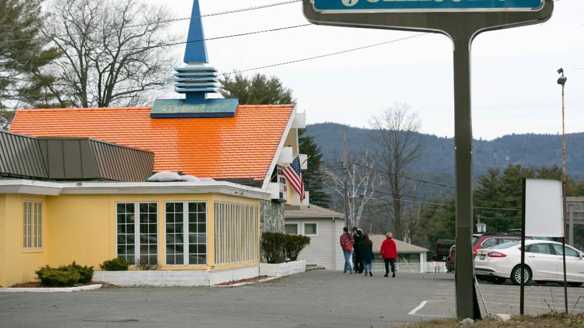 In this Wednesday, April 8, 2015 photo, customers walk into Howard Johnson's Restaurant in Lake George, N.Y. The HoJo's on the main strip of the Adirondack Mountain resort town of Lake George and another in Bangor, Maine, are the last two restaurants operating under the famous name.  (AP Photo/Mike Groll)