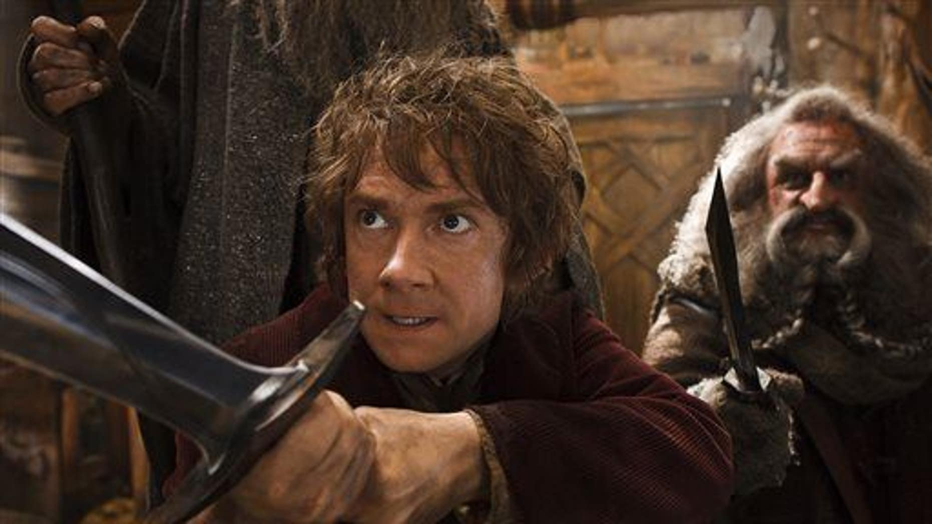 "This image released by Warner Bros. Pictures shows Martin Freeman, left, and John Callen in a scene from ""The Hobbit: The Desolation of Smaug."""