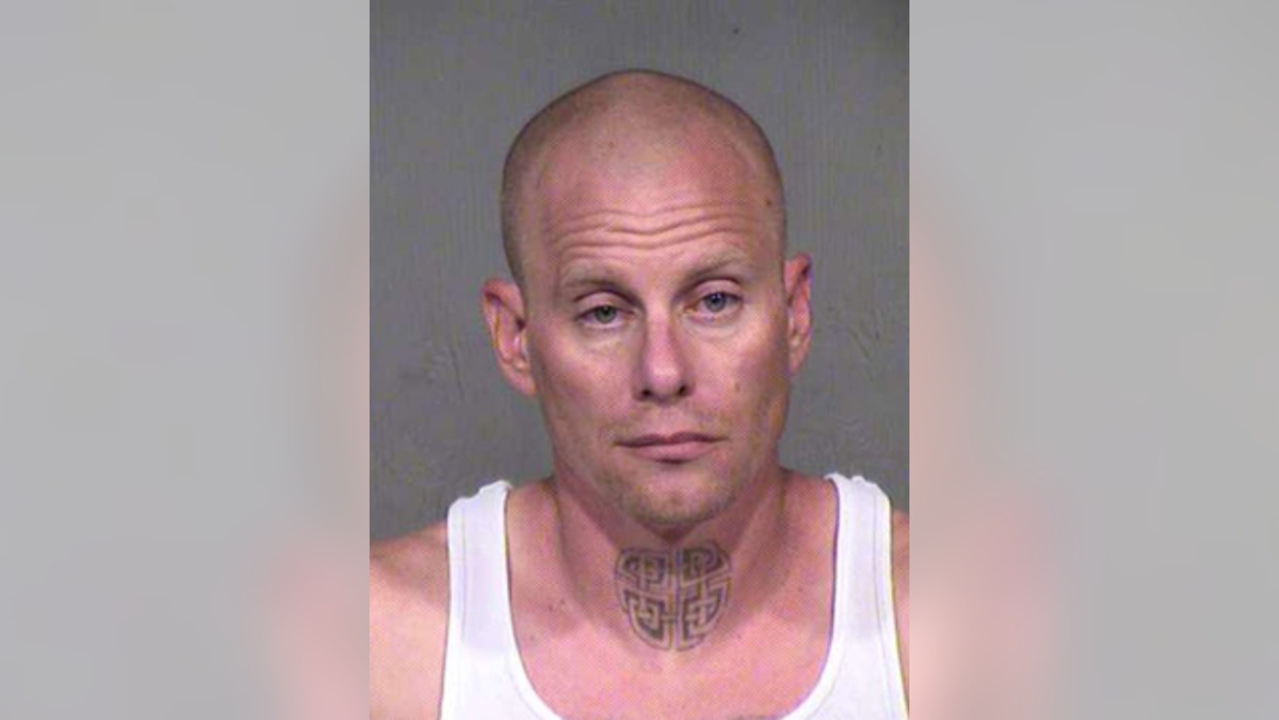 This photo shows Christopher Hoffman, arrested in connection with a drive-by road rage shooting in suburban Phoenix Saturday, Oct. 3, 2015. (Maricopa County Sheriff's Office)
