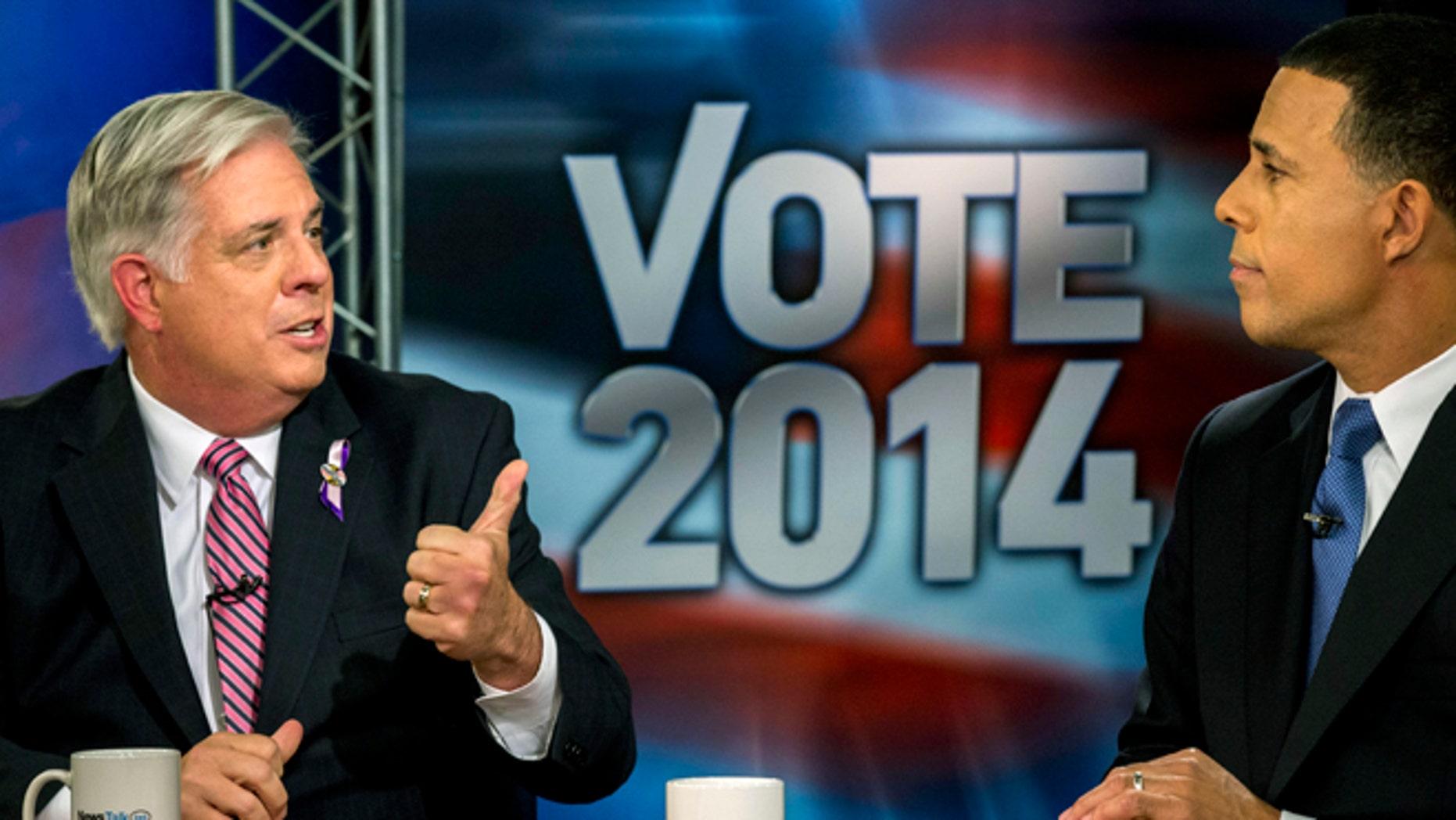 FILE: Oct. 13, 2014: Maryland gubernatorial candidates Larry Hogan, left, and Lt. Gov. Anthony Brown debate in Arlington, Va.