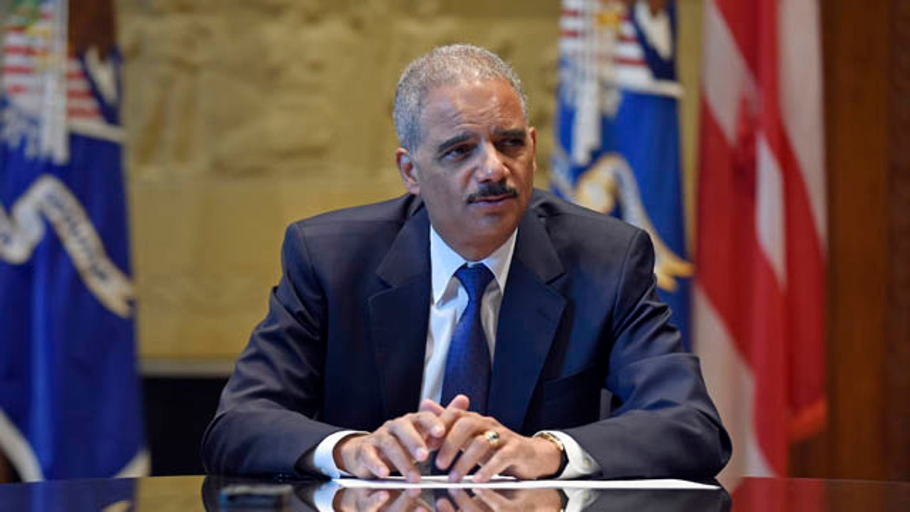 September 16, 2014: Attorney General Eric Holder speaks during an interview with The Associated Press at the Justice Department in Washington. Broadening its push to improve police relations with minorities, the Justice Department has enlisted a team of criminal justice researchers to study racial bias in law enforcement in five American cities and recommend strategies to address the problem nationally, Holder said Tuesday. (AP Photo/Susan Walsh)