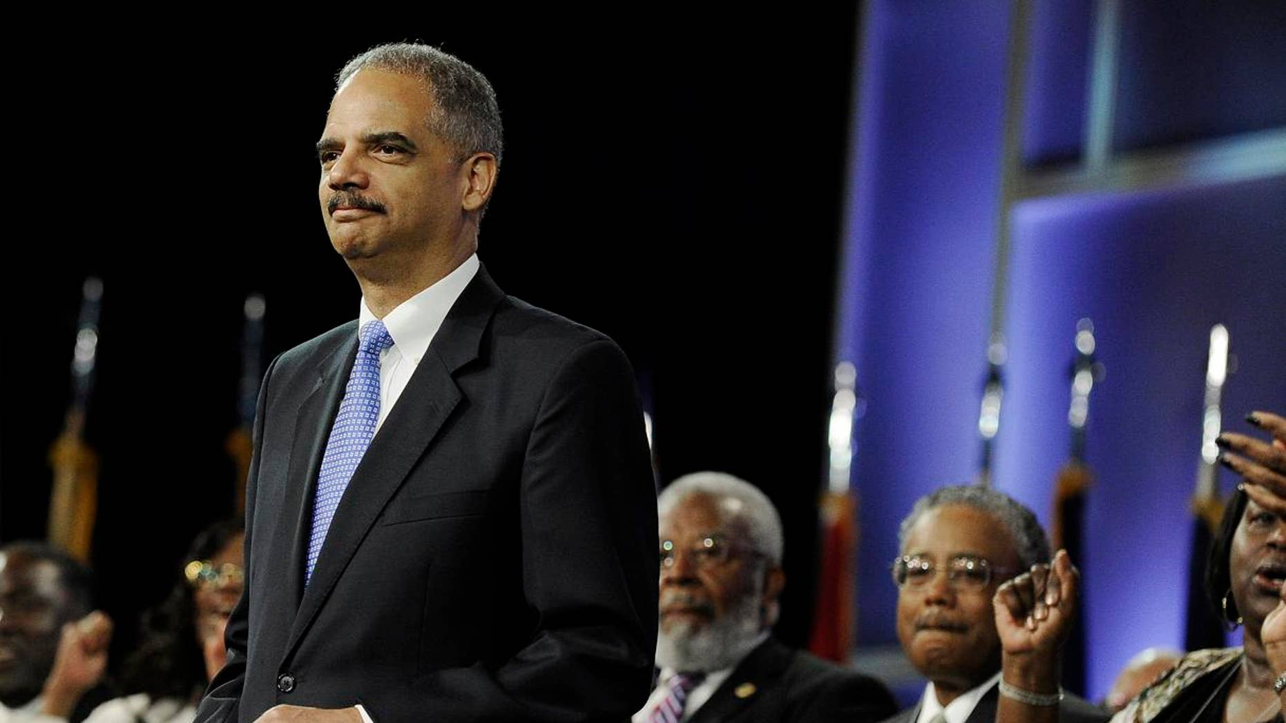 July 10: Attorney General Eric Holder is welcomed at the NAACP annual convention in Houston.