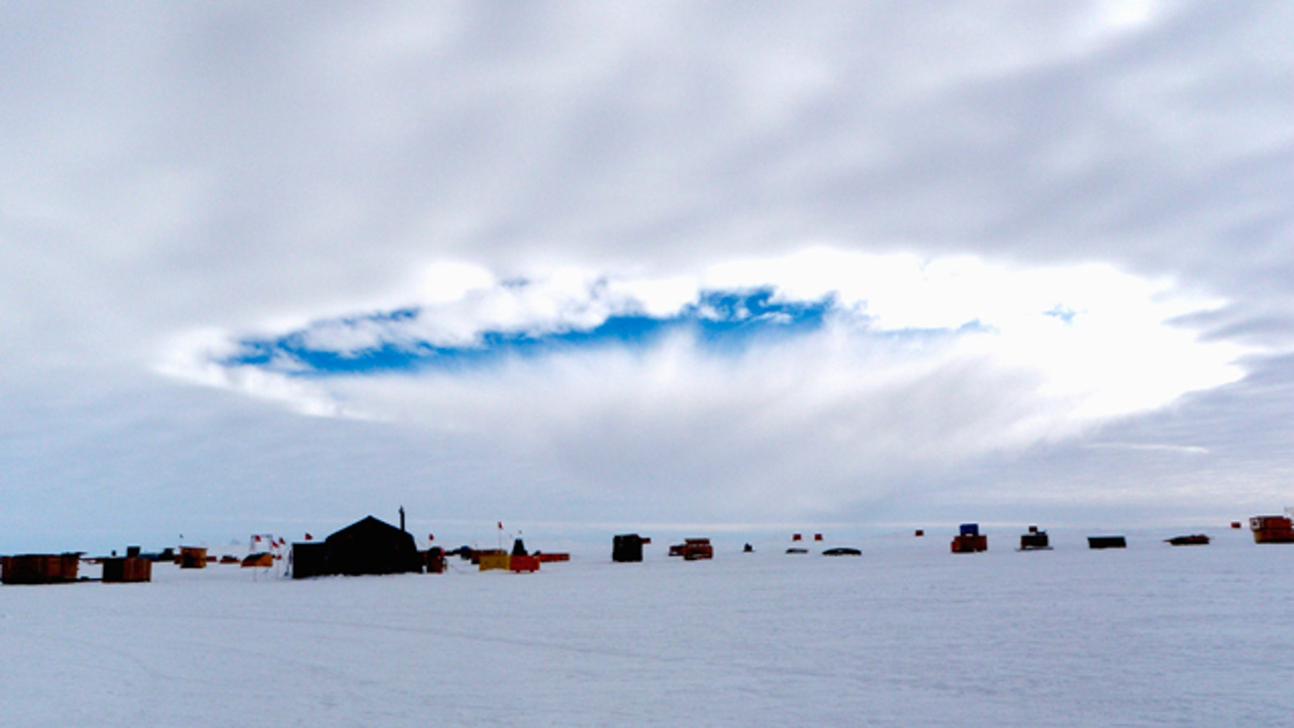 An aircraft-induced hole observed at the West Antarctic Ice Sheet Divide Camp, Antarctica. Airplanes flying through supercooled clouds around airports can cause condensation that results in more snow and rain nearby, according to a new study.