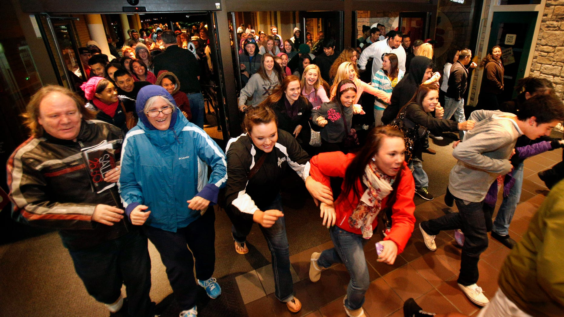 Nov. 23, 2012: Black Friday shoppers pour into the Valley River Center mall for the Midnight Madness sale, in Eugene, Ore.