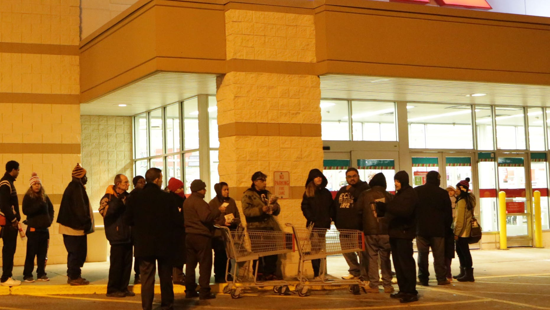 Nov. 27, 2014: Customers line up outside a Kmart store on Thanksgiving morning in Chicago, Ill.