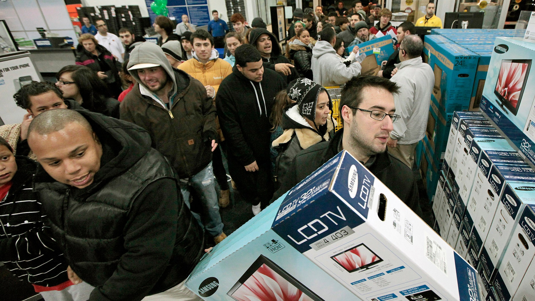 Nov. 25, 2011: Black†Friday shoppers rush into Best Buy in North Dartmouth, Mass.