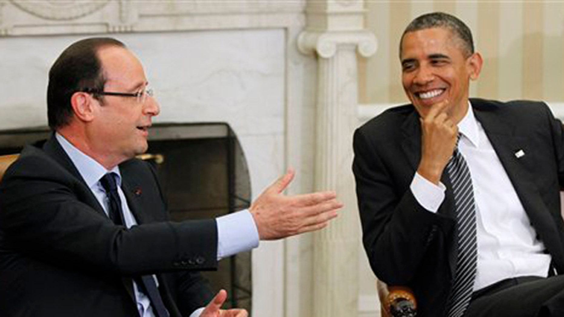 President Barack Obama meets with French President Francois Hollande, Friday, May 18, 2012, in the Oval Office of the White House.
