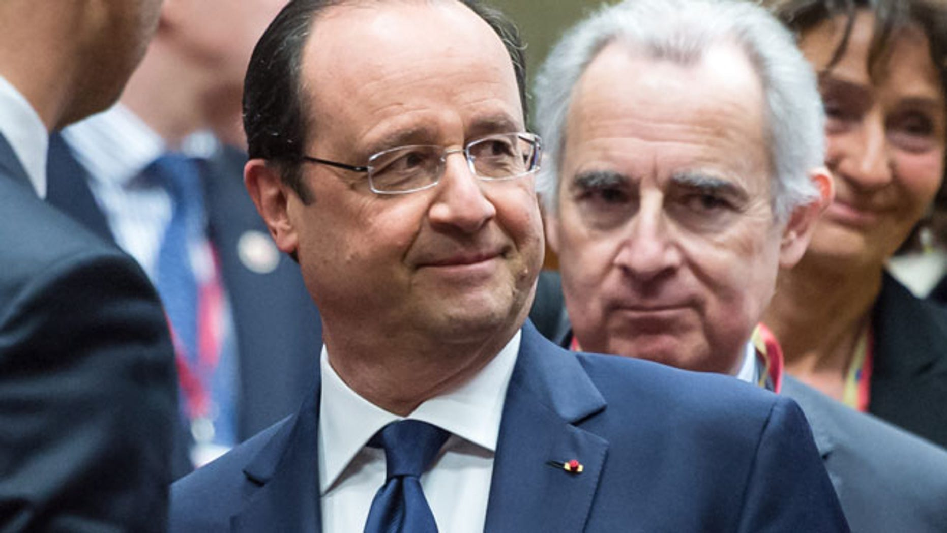 March 6, 2014: French President Francois Hollande, center, speaks with Ukraine's Prime Minister Arseniy Yatsenyuk, left, during a round table meeting at an EU summit in Brussels.