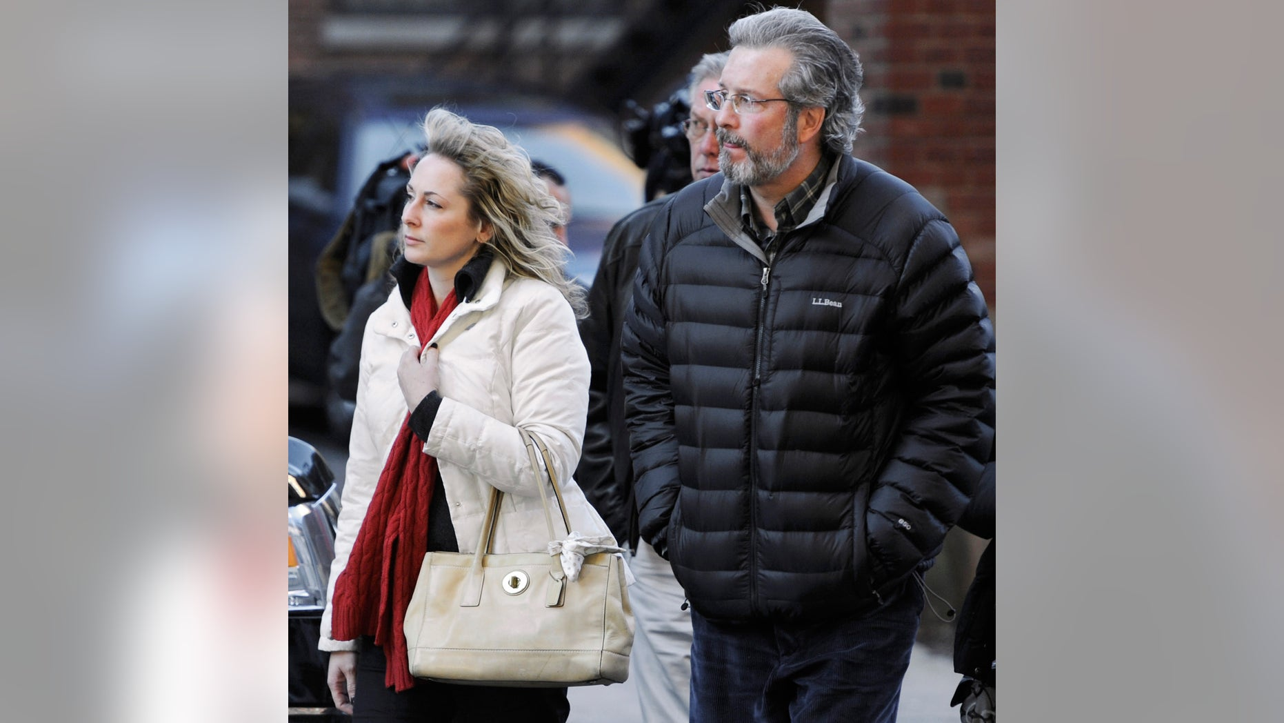 FILE - photo of Dr. William Petit Jr. arriving at  Superior Court in New Haven with friend Christine Paluf.