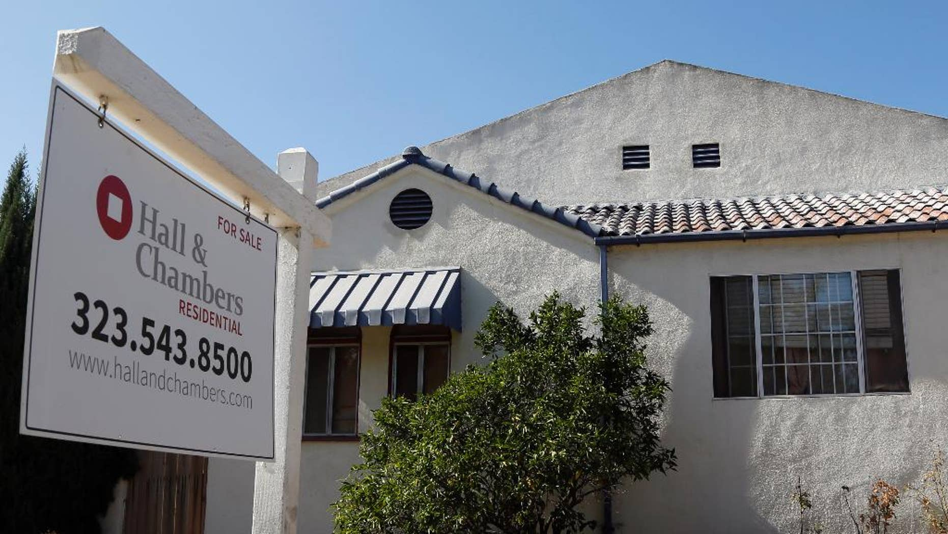 A realty sign hangs outside a home for sale in Los Angeles Monday, Oct 27, 2014. Standard & Poor's releases its 20-city home price index for August on Tuesday, Oct. 28, 2014. (AP Photo/Nick Ut)