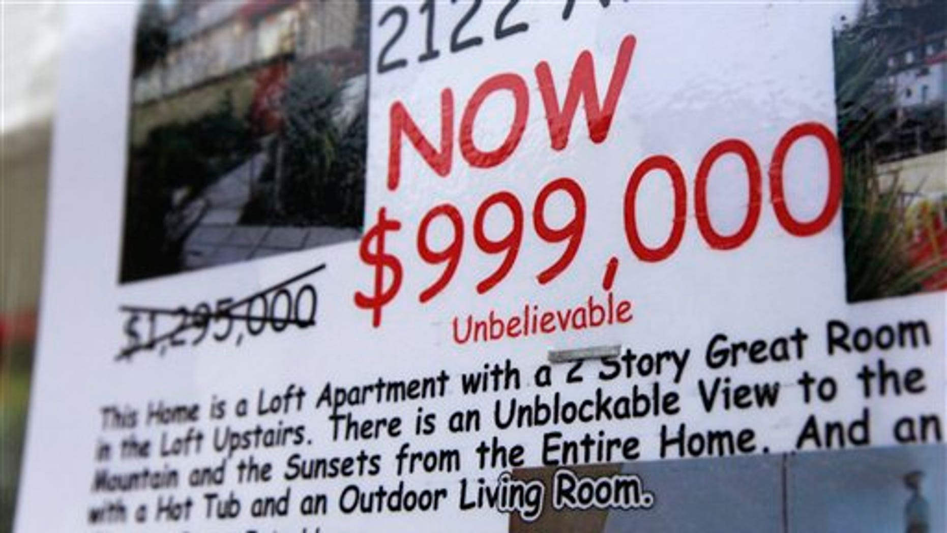 June 2011: A condo with a view and a reduced price is advertised for sale, in Seattle.