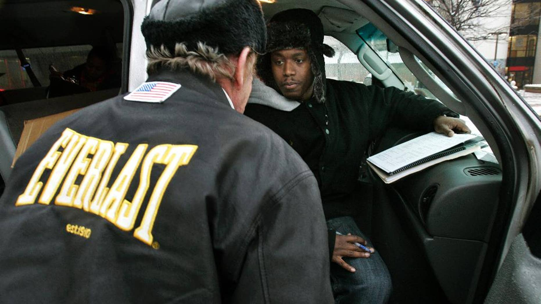 """FILE -  In this Wednesday, Jan. 28, 2009 file photo, Harold """"Hal"""" Miller, right, listens to a homeless man while preparing census forms for homeless people in Camden, N.J. Miller, well known in Camden for working with the city's homeless population, has been arrested and charged with running a drug market in the city. In an indictment dated Sept. 1, federal authorities say 38-year-old Harold """"Hal"""" Miller ran an operation that sold heroin and crack on Pfeiffer Street in East Camden. (AP Photo/Mel Evans, File)"""