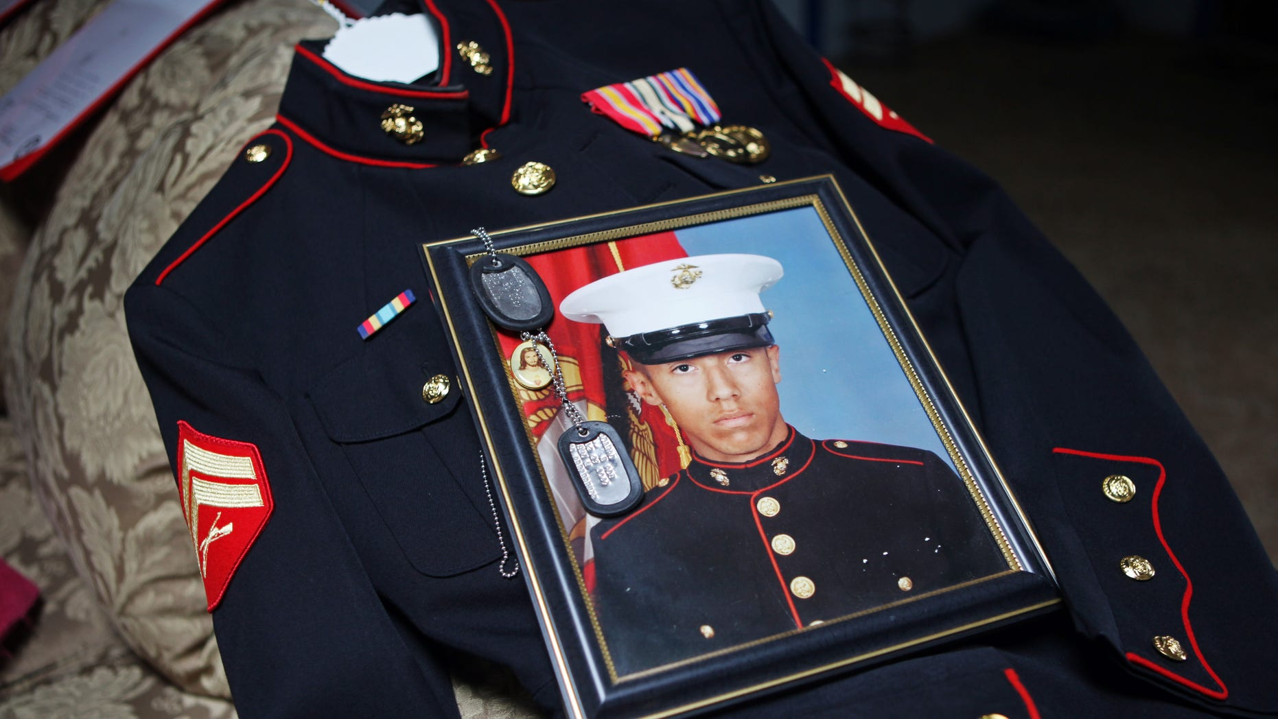 January 15: Itzcoatl Ocampo's dress uniform, government military photo, dog tags and a religious medallion that went to war with him lie on display at Ocampo's home in Yorba Linda, California.