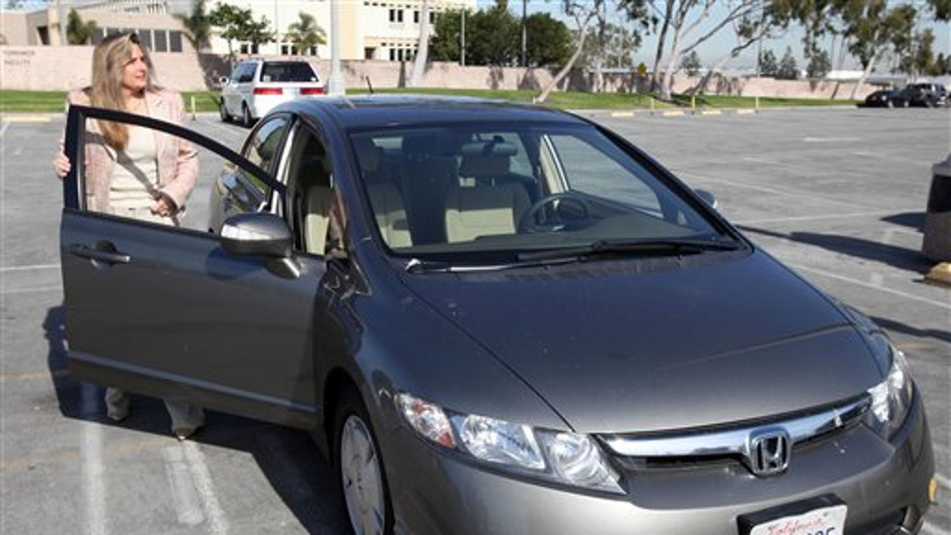 Jan. 3: Heather Peters, who says her 2006 Honda Civic Hybrid never achieved the gas mileage Honda claimed in its advertising, and also did a computer upgrade that further diminished the mileage, arrives at Small Claims Court in Torrrance, California.
