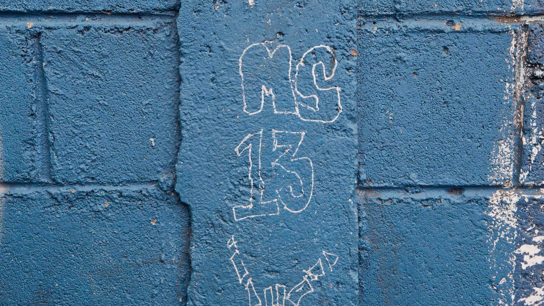 A MS-13 gang graffiti next to door of the Jose Ramon Montoya school in Tegucigalpa, Honduras.