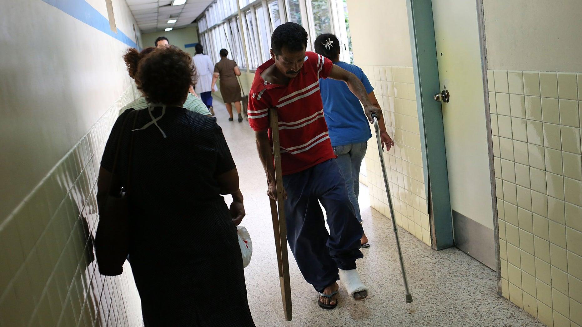 A man limps through the hallways of a public hospital on July 19, 2012 in Tegucigalpa, Honduras.