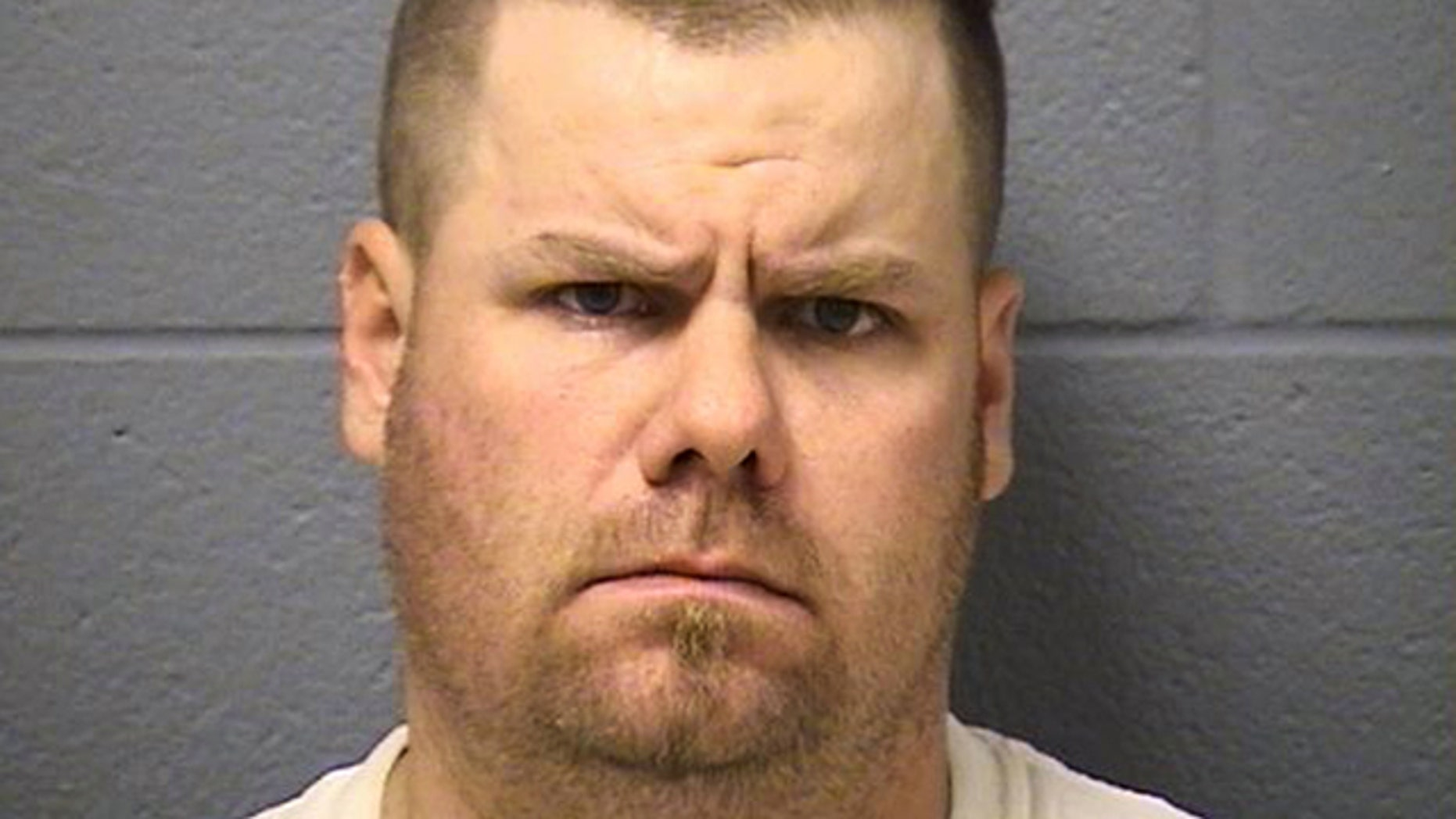 Brian Dorian, seen in this photo released by the Will County Sheriff's Office, is a former Illinois police officer suspected in a series of shootings that killed one man and wounded two others.
