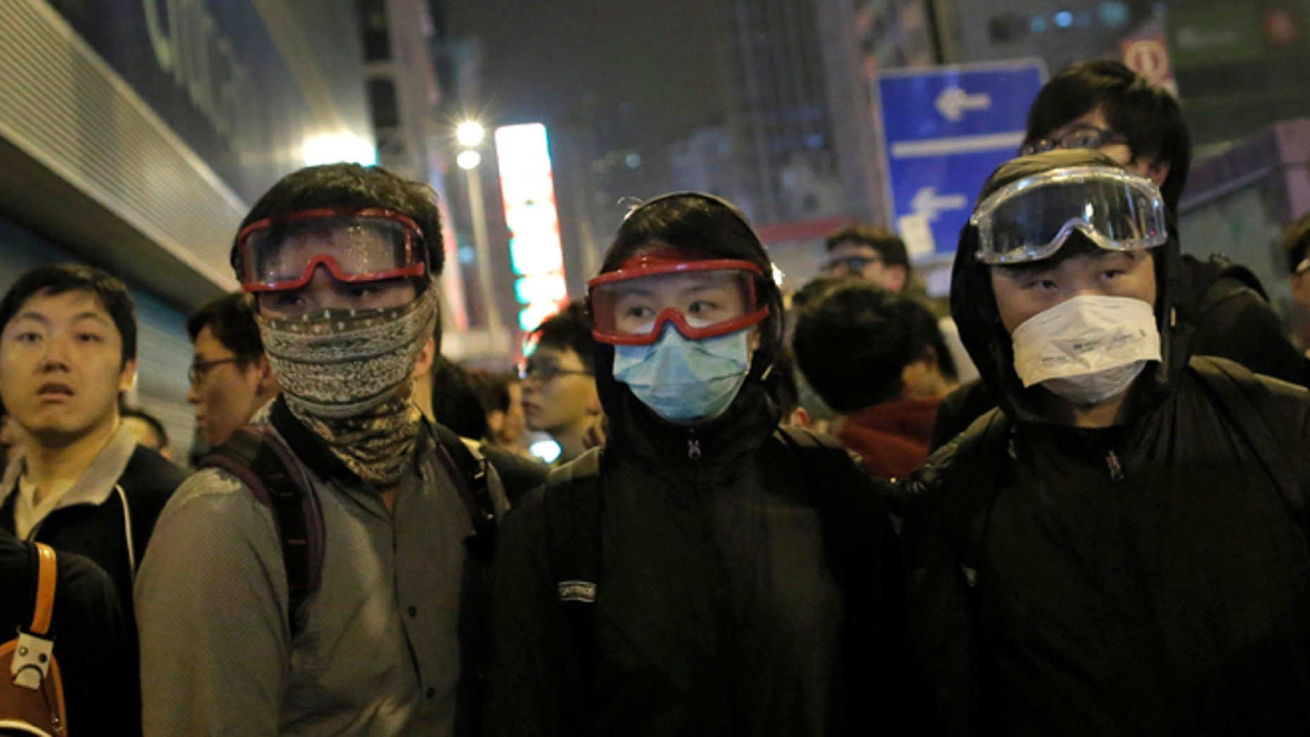 Nov. 29, 2014; Protesters wear mask during a standoff with policemen in Mong Kok district of Hong Kong. (AP)