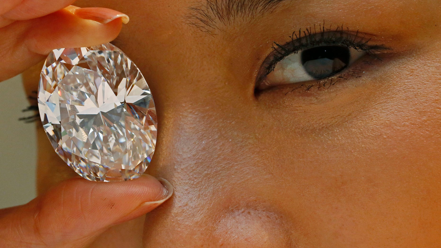Sept. 19, 2013 - FILE -  A 118.28-carat white diamond is at Sotheby's auction house in Hong Kong. The white diamond the size of a small egg has sold for $27.3 million. A phone bidder bought the rock from Africa at the Oct. 7 sale.