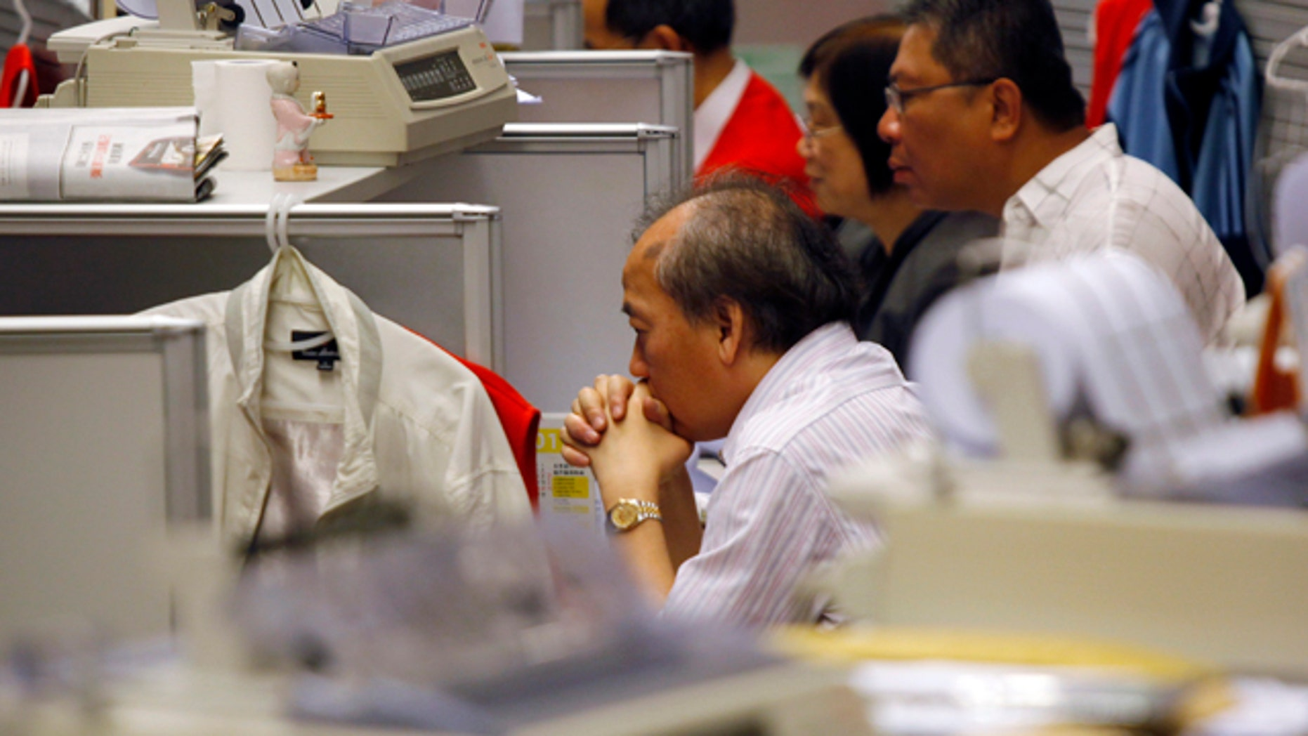 Aug. 9, 2011: A trader reacts at the Hong Kong Stock Exchange in Hong Kong in the morning session.