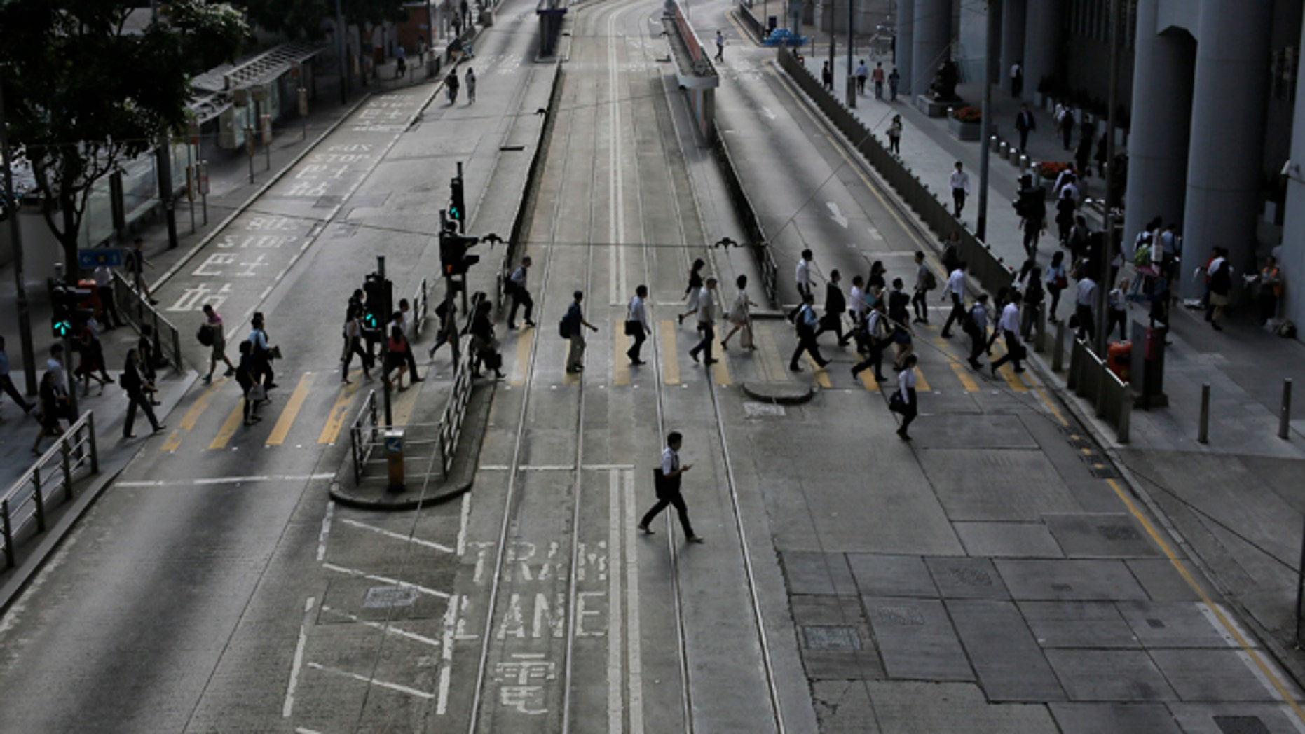 Oct. 9: People walk to work in the occupied areas at Central district in Hong Kong.