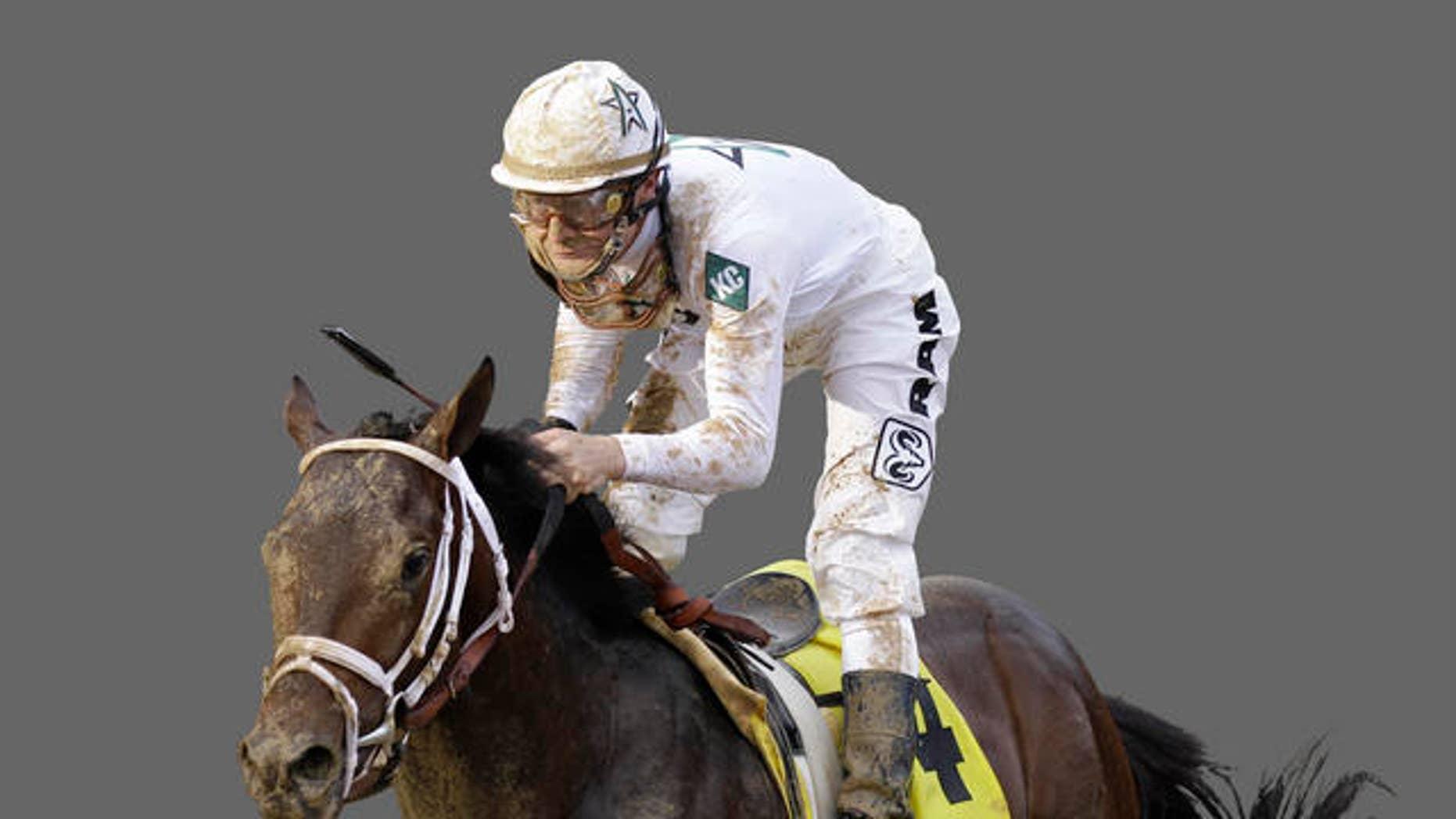 Calvin Borel rides Super Saver to a victory during the 2010 Kentucky Derby/AP Photo