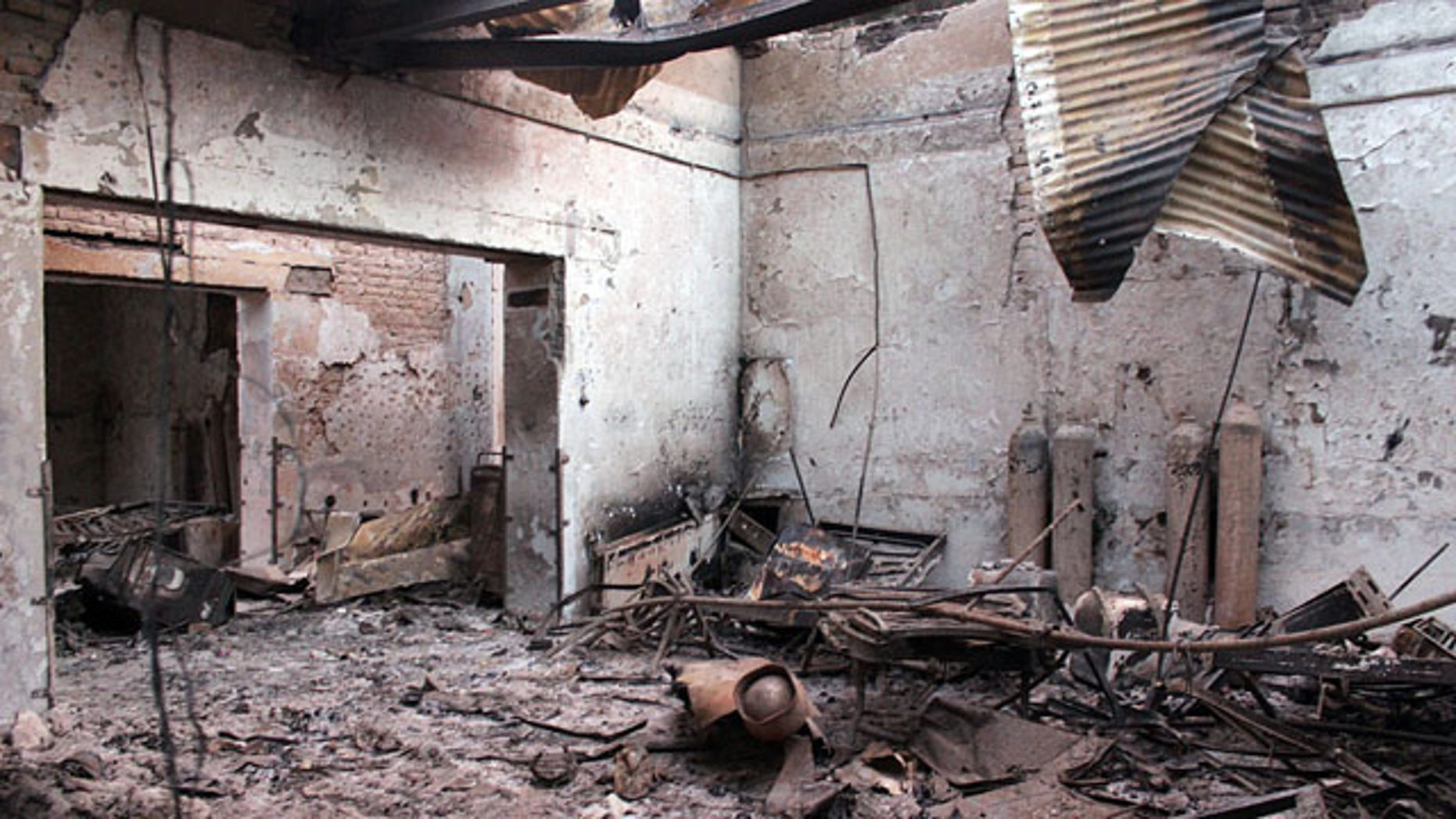 FILE - In this Oct. 16, 2015 file photo, the charred remains of the Doctors Without Borders hospital is seen after being hit by a U.S. airstrike in Kunduz, Afghanistan. (Najim Rahim via AP, File)