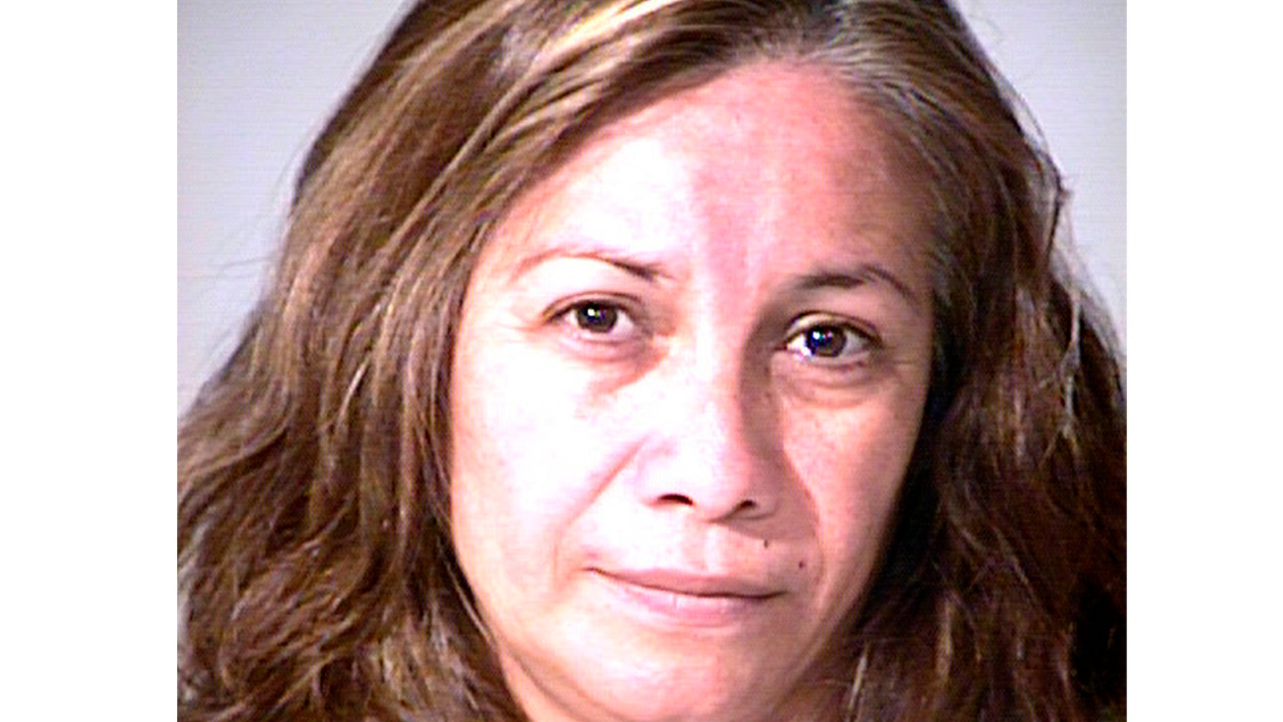 Grisel Ramirez, 48, is seen in custody after she was caught trying to steal a newborn girl from a Southern California hospital in a tote bag.