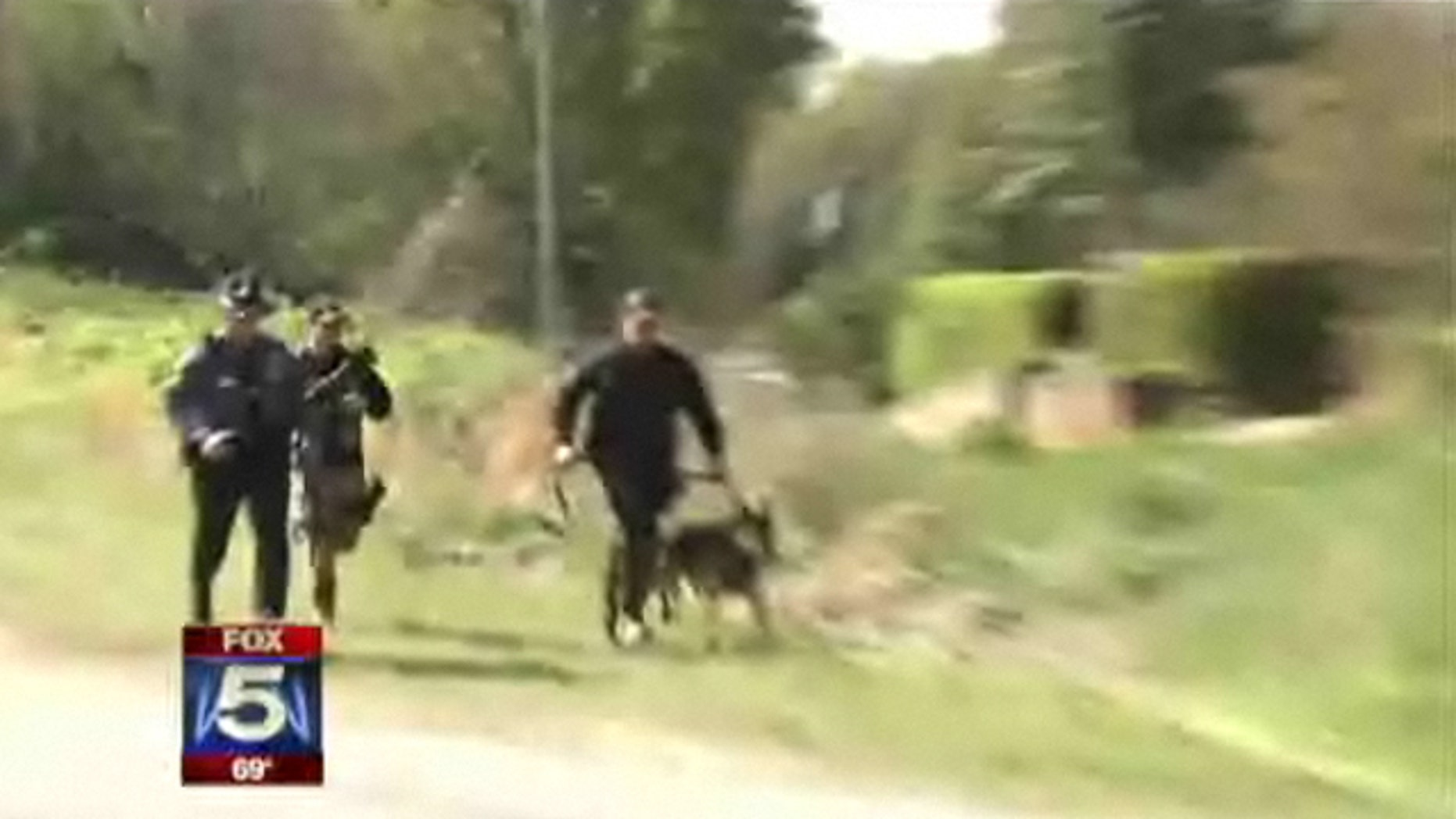 March 25, 2011: Police in Georgia respond to a hostage situation with the suspect in the shooting death of an officer earlier in the week.