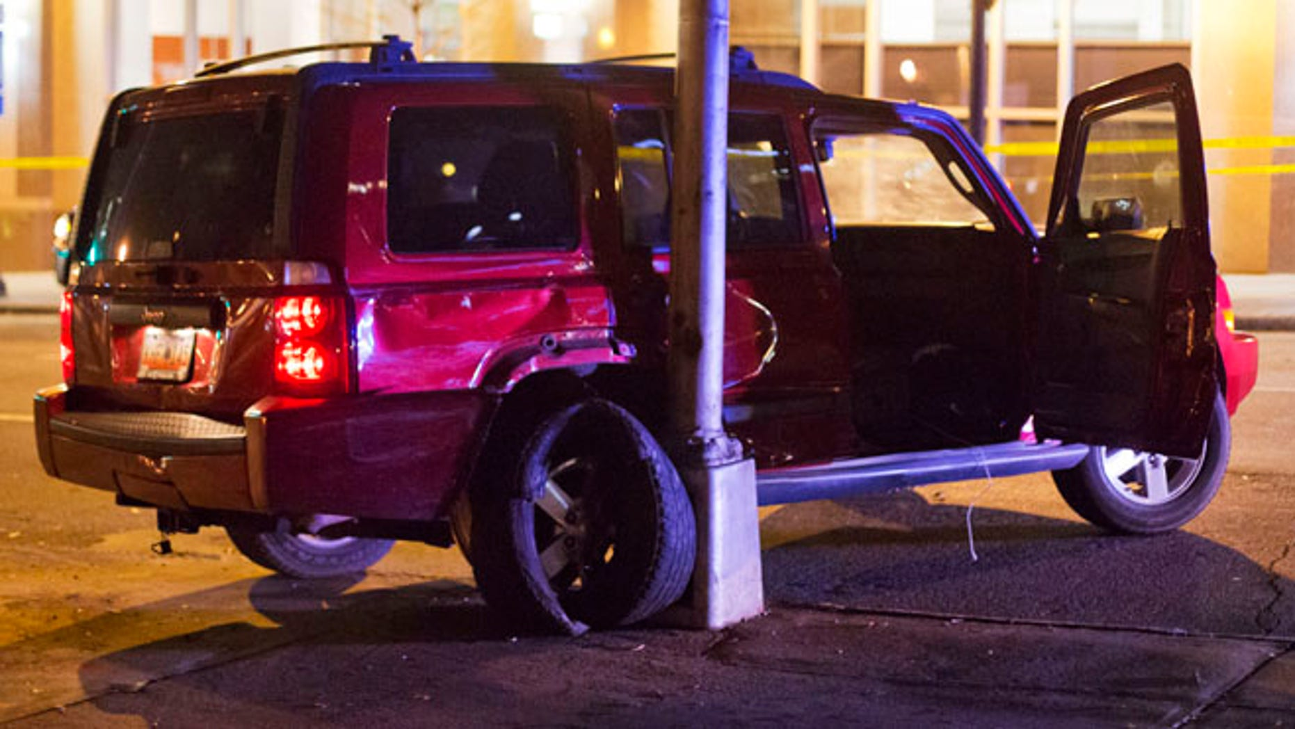 A vehicle is shown at the scene of an officer-involved shooting in downtown Atlanta.